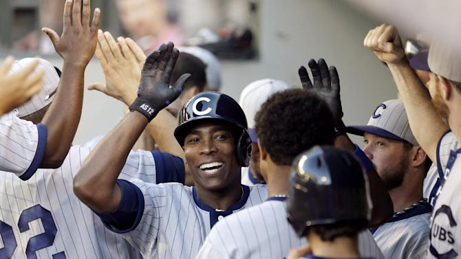 FILE - Chicago Cubs' Alfonso Soriano is congratulated in the dugout on his two-run home run against the Seattle Mariners in the 11th inning of a baseball game in this June 29, 2013 file photo taken in Seattle. Chicago players were upset about the news of teammate Alfonso Soriano's impending trade to the Yankees, and manager Dale Sveum thought that played a part in the Cubs' 3-1 loss to the Arizona Diamondbacks Thursday July 25, 2013. (AP Photo/Elaine Thompson, File)