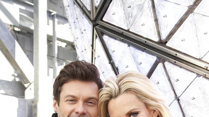Entertainers Ryan Seacrest, left, and Jenny McCarthy, hosts of Dick Clark's New Year's Rockin' Eve on ABC, pose for a portrait Friday, Dec. 28, 2012 in New York. (Photo by Dan Hallman/Invision/AP Images)