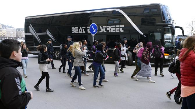 FILE - This Tuesday April 23, 2013, photo from files shows young girls running towards pop singer Justin Bieber's tour bus as it parks outside Grand Hotel where Bieber were staying during his concerts in Stockholm, Sweden. Swedish police said on Thursday they found drugs on Bieber's tour bus in Stockholm, but had no suspects and were unlikely to pursue the case further. (AP Photo/Scanpix Sweden, Leo Sellen, File)   SWEDEN OUT