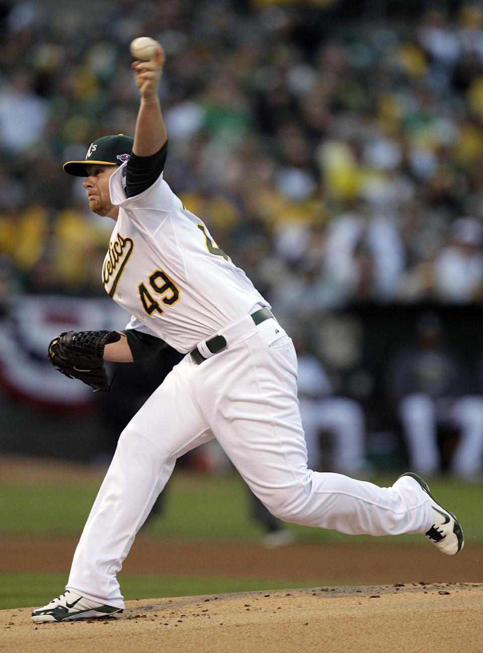 Oakland Athletics starting pitcher Brett Anderson throws during the first inning of Game 3 of the Athletics' American League division baseball series against the Detroit Tigers in Oakland, Calif., Tuesday, Oct. 9, 2012. (AP Photo/Ben Margot)