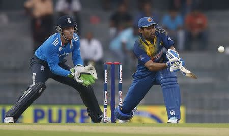 Sri Lanka's Dilshan plays a shot next to England's Buttler during their first ODI cricket match in Colombo