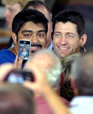 Republican vice presidential candidate, Paul Ryan poses for a photo with a supporter during a campaign stop on August 12, 2012 in High Point, North Carolina. Republican presidential candidate Mitt Romney and Ryan are on a 4-day bus trip that will take Romney to 4 key swing states, Virginia, North Carolina, Florida and Ohio, and also to Ryan's home state of Wisconsin