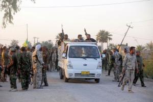 Shi'ite fighters participate in an intensive security…