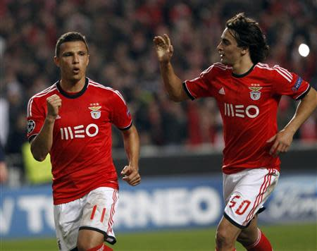 Benfica's Lima (L) celebrates beside team mate Markovic after scoring a penalty against Paris St Germain during their Champions League soccer match in Lisbon