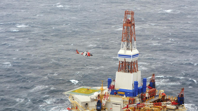 In this photo provided by the United States Coast Guard, a Coast Guard helicopter crew from Air Station Kodiak conducts the 13th hoist of 18 crewmen from the mobile drilling unit Kulluk on Saturday, Dec. 29, 2012, 80 miles southwest of Kodiak City, Alaska. The tug Aiviq suffered problems towing the Kulluk Thursday prompting the Coast Guard to deploy cutters and aircraft to while Royal Dutch Shell dispatched additional tugs.(AP Photo/United States Coast Guard, Petty Officer 1st Class Sara Francis)