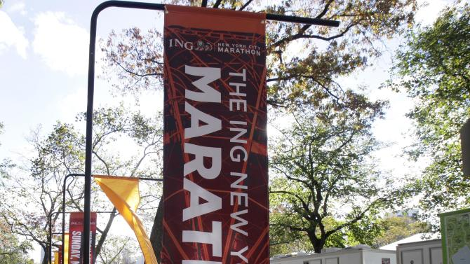 New York City Marathon banners adorn an entrance to New York's Central Park, Friday, Nov. 2, 2012. The course for Sunday's New York City Marathon will be the same since there was little damage but getting to the finish line could still be an adventure for runners from outlying areas. Such is life in Sandy's aftermath — disrupted trains, planes, buses and ferries, flooded buildings, blocked roads and knocked out power. (AP Photo/Richard Drew)