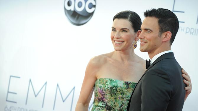 Actress Julianna Margulies, left and husband Keith Lieberthal arrive at the 64th Primetime Emmy Awards at the Nokia Theatre on Sunday, Sept. 23, 2012, in Los Angeles.  (Photo by Jordan Strauss/Invision/AP)