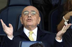 AC Milan's vice president Galliani gestures as he arrives to watch their Italian Serie A soccer match against Chievo Verona in Verona