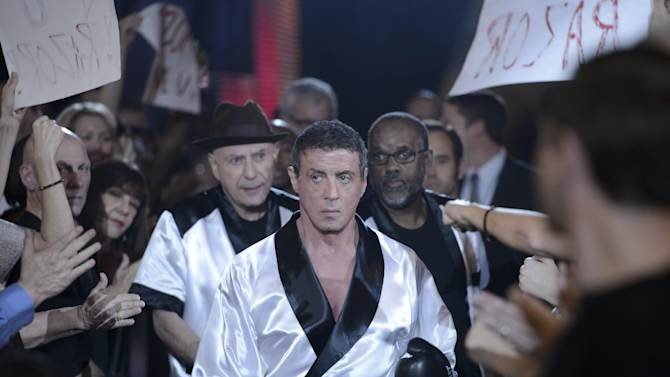 "This image released by Warner Bros. Pictures shows Sylvester Stallone as Henry ""Razor"" Sharp, center, and Alan Arkin as Louis ""Lightning"" Conlon, center left, in a scene from ""Grudge Match."" (AP Photo/Warner Bros. Pictures, Ben Rothstein)"