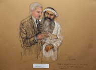 This courtroom drawing shows Khalid Sheikh Mohammed consulting defense attorney civilian David Nevin at the US Naval Base in Guantanamo Bay, Cuba. The five men accused of plotting the deadly September 11, 2001 attacks in the US, including Mohammed, were formally charged at the military tribunal