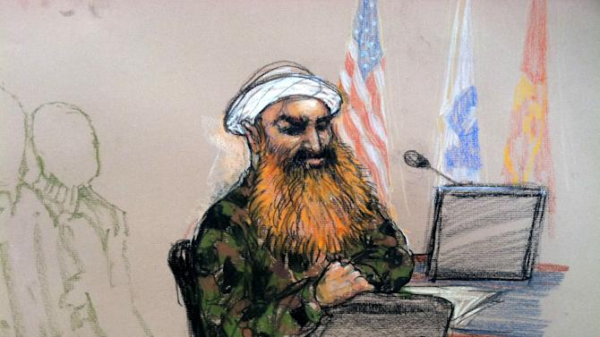 In this pool photo of a sketch by courtroom artist Janet Hamlin and reviewed by the U.S. Department of Defense, the self-proclaimed terrorist mastermind Khalid Sheikh Mohammed, wearing a camouflage jacket and white turban, is seen during a break in the pretrial hearings at the Guantanamo Bay U.S. Naval Base in Cuba, Monday, June 17, 2013. Five Guantanamo Bay prisoners accused of helping orchestrate the Sept. 11 terrorist attacks returned to court Monday as arguments resumed over the preparations for a trial that remains distant. (AP Photo/Janet Hamlin, Pool)