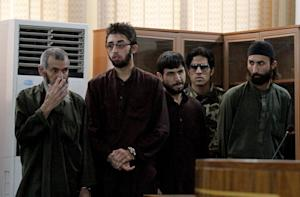 Defendants attend their trial at the Primary Court …