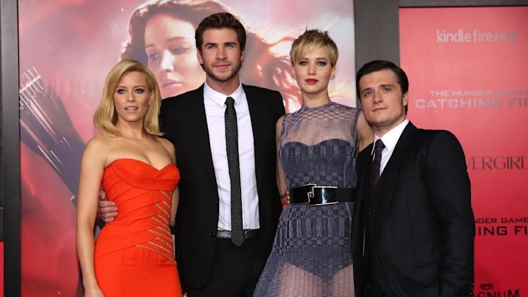 "Elizabeth Banks, Liam Hemsworth, Jennifer Lawrence and Josh Hutcherson attend the LA premiere of ""The Hunger Games: Catching Fire"" on Monday, Nov. 18, 2013 in Los Angeles. (Photo by Matt Sayles/Invision/AP)"