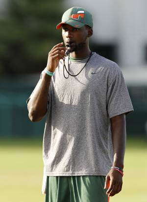 """Miami quarterback Jacory Harris stands with a whistle in his mouth during football practice in Coral Gables, Fla., Thursday, Aug. 18, 2011. Harris did not practice in the morning session. The latest scandalous allegations in college football _ this time at the University of Miami _ have renewed talk by the NCAA of the need for """"fundamental change"""" in athletics. (AP Photo/Lynne Sladky)"""