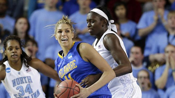 Delaware's Elena Delle Donne, front, drives around North Carolina forward Xylina McDaniel (34) and center Waltiea Rolle during the first half of a second-round game in the women's NCAA college basketball tournament in Newark, Del., Tuesday, March 26, 2013. (AP Photo/Patrick Semansky)
