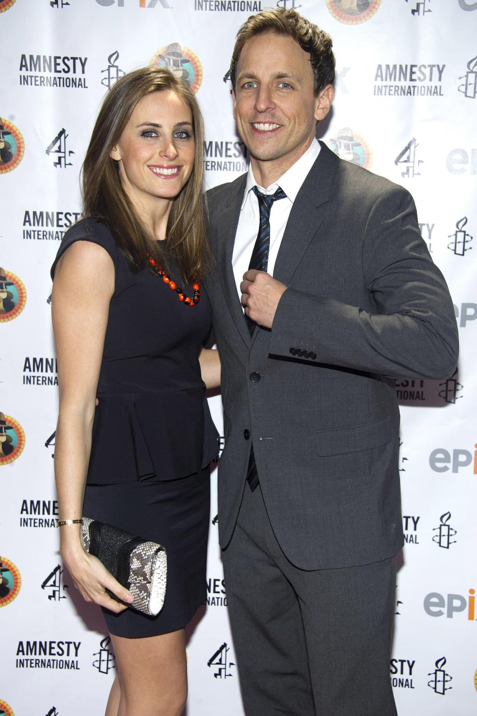 "Seth Meyers and Alexi Ashe arrive to Amnesty International's ""Secret Policeman's Ball"" in New York, Sunday, March 4, 2012. (AP Photo/Charles Sykes)"