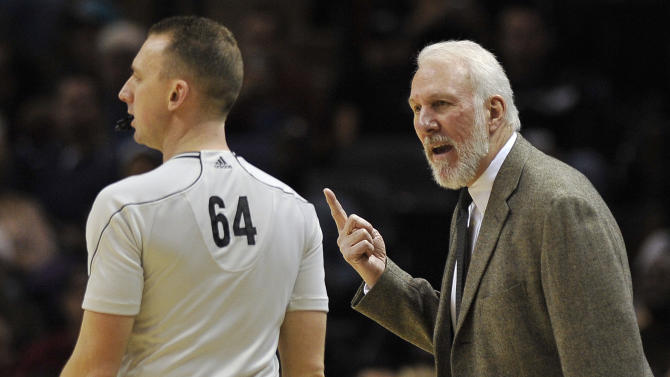 San Antonio Spurs head coach Gregg Popovich, right, talks to referee Justin Van Duyne during the first half of an NBA basketball game against the Memphis Grizzlies, Wednesday, Dec. 17, 2014, in San Antonio. (AP Photo/Darren Abate)
