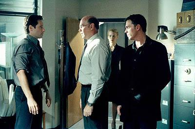 "Agent Mulder (David Duchovny, L), Skinner (Mitch Pileggi), Marita Covarrubias (Laurie Holden) and Alex Krycek (Nicholas Lea, R) in the ""Requiem"" episode of Fox's The X-Files X-Files"