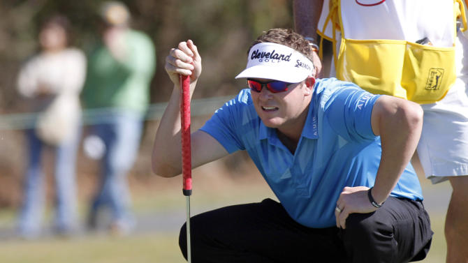 Charlie Beljan lines up his putt on the eighth green during the third round of the Children's Miracle Network Hospitals golf tournament in Lake Buena Vista, Fla., on Saturday, Nov. 10, 2012. (AP Photo/Reinhold Matay)