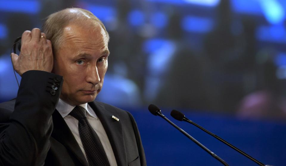 Russia's President Vladimir Putin listens to the translation of a question during a press conference at the G20 summit in Los Cabos, Mexico, Tuesday, June 19, 2012. (AP Photo/Esteban Felix)