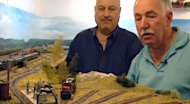 Peter Catalano and George Jarvis survey a section of their miniature railway.
