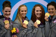 US gold medalists Missy Franklin, Dana Vollmer, Shannon Vreeland and Allison Schmitt celebrate on the podium after the women's 4x200m freestyle relay final swimming event at the London 2012 Olympic Games in London