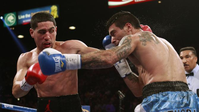 WBC/WBA junior welterweight champion Garcia of the U.S. connects on Matthysse of Argentina during their title fight at the MGM Grand Garden Arena in Las Vegas