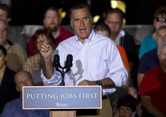 Republican presidential candidate, former Massachusetts Gov. Mitt Romney gestures during a campaign stop at Weatherly Casting Company in Weatherly, Pa., Saturday, June 16, 2012. (AP Photo/Evan Vucci)