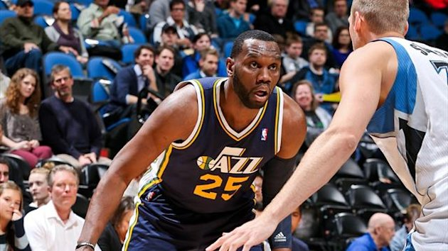 Al Jefferson of the Utah Jazz in action against Greg Stiemsma of the Minnesota Timberwolves (AFP)
