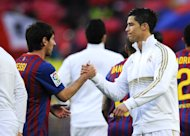 Lionel Messi dan Cristiano Ronaldo saat El Clasico. (Getty Images/David Ramos)