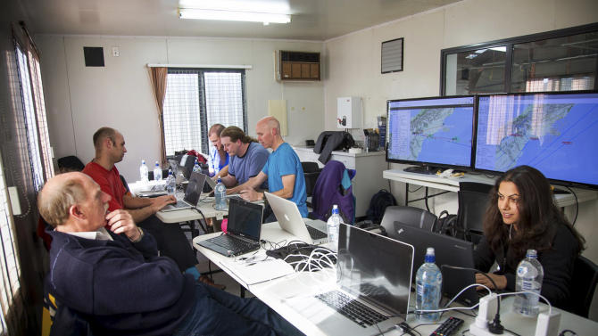 In this June 12, 2013 photo released by Google, Google's team at mission control monitors a balloon launch in Christchurch, New Zealand. Google is testing the balloons which sail in the stratosphere and beam the Internet to Earth. (AP Photo/Google, Andrea Dunlap) EDITORIAL USE ONLY
