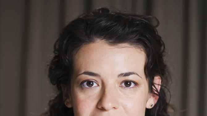 "This 2012 photo released by The Hartman Group shows playwright Quiara Alegria Hudes. Hudes wrote the play ""Water by the Spoonful."" (AP Photo/The Hartman Group, Joshua Lehrer)"