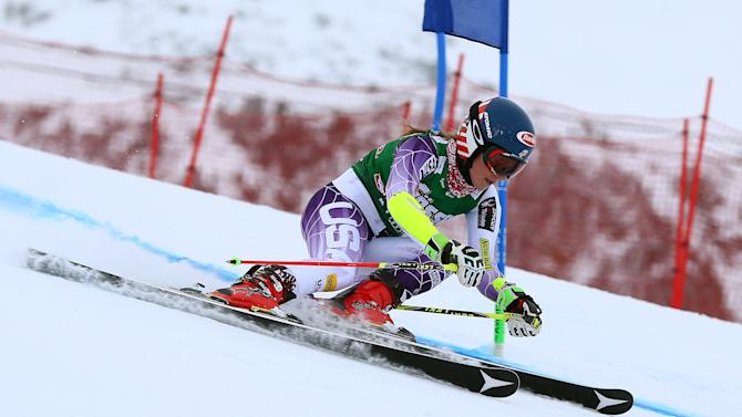 Mikaela Shiffrin of the United States competes on her way to clock the fastest time during the first run of an alpine ski, women's World Cup giant slalom in Kuehtai, Austria, Sunday, Dec. 28, 2014. (AP Photo/Giovanni Auletta)