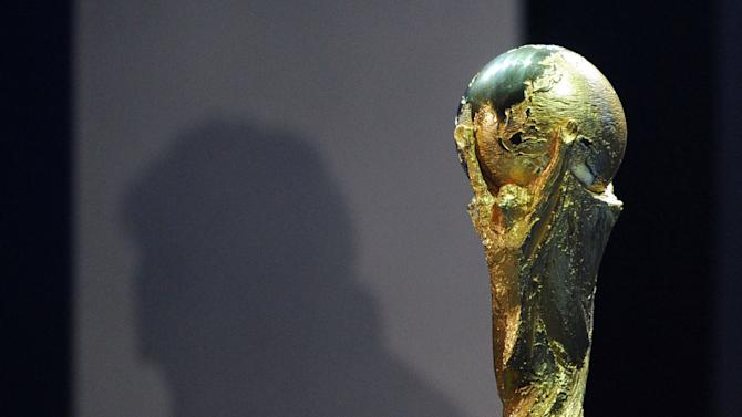 The FIFA World Cup trophy is displayed during the Kick-off Concert at the Orlando Stadium in Johannesburg on June 10, 2010