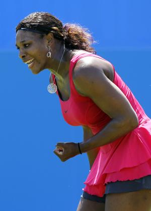 Serena Williams of the U.S. reacts during her singles tennis match against Tsvetana Pironkova of Bulgaria at the Eastbourne International grass court tennis tournament in Eastbourne, England, Tuesday, June 14, 2011. (AP Photo/Kirsty Wigglesworth)