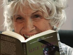 "Canadian author Alice Munro with a copy of ""Friend of My Youth"""