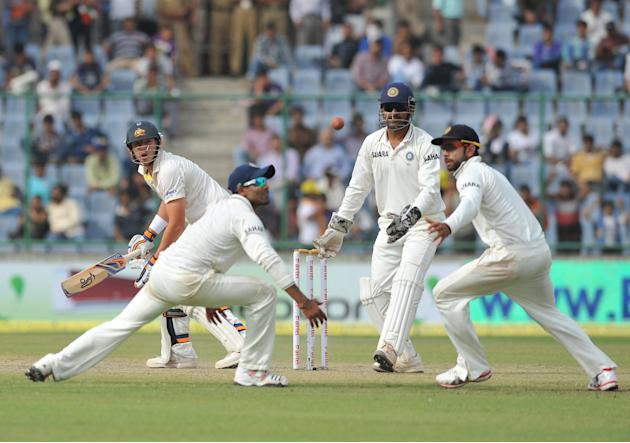 Dhoni, Virat Khohli and Ajankya Rahane of India catching as Peter Siddle of Australia miss the target during the 4th test match of Border Gavaskar Trophy, at Ferozeshah Kotla Stadium in Delhi on March
