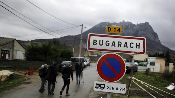 Pic de Bugarach mountain rises above the small town of Bugarach, France, Friday, Dec. 21, 2012. Although the long expected end of the Mayan calendar has come, the New Age enthusiasts have steered clear from the sleepy French town of Bugarach, which gave some locals a chance to joke about the end of the world legends that surround the area. (AP Photo/Marko Drobnjakovic)