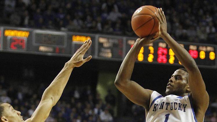 Kentucky's Darius Miller, right, shoots next to Loyola's Erik Etherly during the first half of an NCAA college basketball game in Lexington, Ky., Thursday, Dec. 22, 2011.  (AP Photo/James Crisp)