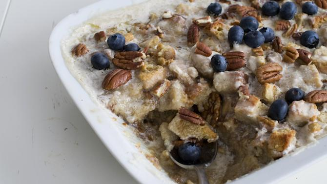 In this image taken on Jan. 28, 2013, banana bourbon bread pudding is shown in a serving dish in Concord, N.H. (AP Photo/Matthew Mead)