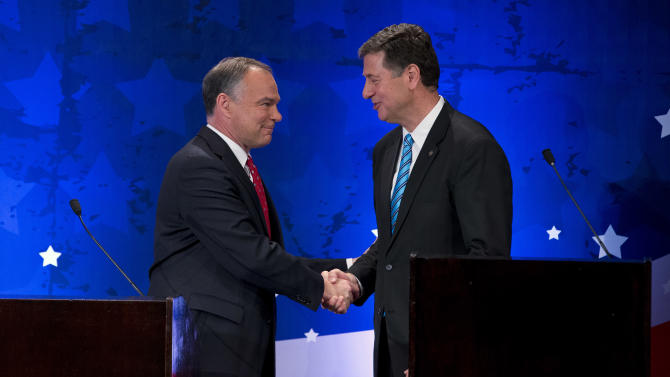 In this Sept. 20, 2012, file photo, Republican candidate George Allen, right, and Democratic candidate Tim Kaine shake hands during a Senatorial debate for the Virginia U.S. Senate seat in McLean, Va. With Election Day just four weeks off, congressional candidates in both parties are avoiding answering questions that could alienate critical voter groups like women and seniors. Allen, for instance, won't tell you how he feels about a law requiring Virginia women seeking abortions to have abdominal ultrasounds.  (AP Photo/ Evan Vucci, File)