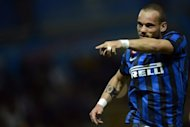 Inter Milan's Wesley Sneijder celebrates after scoring against Parma during their Italian Serie A match in Parma's Tardini Stadium, on May 2. Inter play cross-city rival AC Milan next, at Stadio Giuseppe Meazza, on Sunday