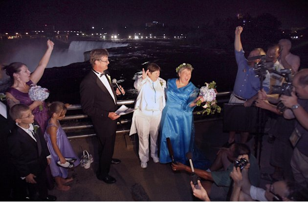 FILE - In this July 23, 2011 file photo, Kitty Lambert, right, and Cheryle Rudd celebrate their marriage in Niagara Falls, N.Y. In recent years, for economic reasons, Niagara Falls has thrown open its