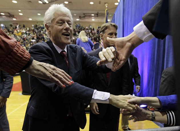 Former President Bill Clinton shakes hands with supporters after speaking at a &quot;Hoosier Common Sense&quot; rally for Indiana Democratic Senate candidate Joe Donnelly and Democratic Indiana gubernatorial candidate John Gregg in Indianapolis, Friday, Oct. 12, 2012. (AP Photo/Michael Conroy)