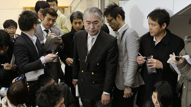 JGC Corporation, or Nikki Manager of public relations Takeshi Endo, center, arrives for a press conference following Wednesday's attack at a natural gas complex in Algeria which involves the company's workers, at its headquarters in Yokohama, near Tokyo Thursday, Jan. 17, 2013. A militant group that claimed responsibility said 41 foreigners were being held after the assault on one of oil-rich Algeria's energy facilities.  (AP Photo/Kyodo News)  JAPAN OUT, MANDATORY CREDIT, NO LICENSING IN CHINA, HONG KONG, JAPAN, SOUTH KOREA AND FRANCE
