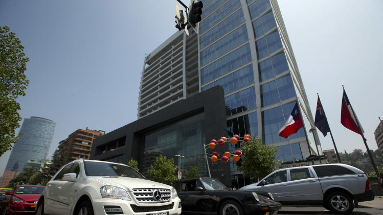 "Luxury cars drive past a five-star hotel in the financial district of Santiago, Chile, Thursday, Jan. 24, 2013. European, Latin American and Caribbean leaders gathering for this weekend's economic summit will likely see only one side of Chile _ the polished, upscale country where tourists and investors stay in five-star hotels in a sparklingly clean financial district nicknamed ""Sanhattan,"" well away from Santiago's slums. (AP Photo/Victor R. Caivano)"