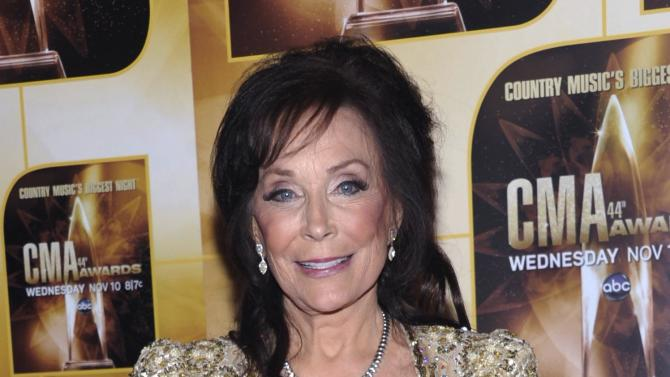 FILE - In this Wednesday, Nov. 10, 2010 file photo, singer Loretta Lynn poses in the press room during the 44th Annual Country Music Awards in Nashville, Tenn. Lynn has been sidelined by knee surgery. A statement says the country music icon will cancel dates through a Sept. 3 show at her Hurricane Mills, Tenn., ranch. (AP Photo/Evan Agostini, File)