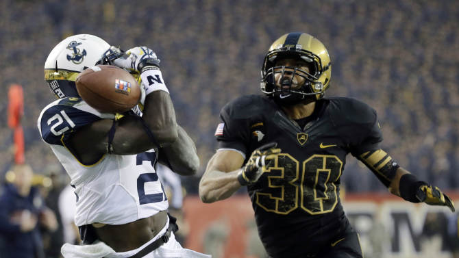 Navy's Gee Gee Greene, left, cannot hang on to a pass in the end zone as Army's Brandon Fusilier-Jeffires defends during the first half of an NCAA college football game, Saturday, Dec. 8, 2012, in Philadelphia. (AP Photo/Matt Slocum)