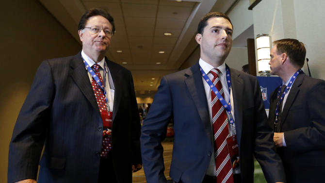 San Francisco 49ers football team owner John York, left, walks through a hotel with his son, 49ers CEO Jed York, during a break in the NFL spring meeting in Boston, Tuesday, May 21, 2013. Later Tuesday, owners will vote on the sites of the 50th and 51st Super Bowls. The San Francisco Bay Area and Florida are bidding for the 2016 game. The loser for that game will face Houston for the right to hold the 2017 Super Bowl.  (AP Photo/Elise Amendola)