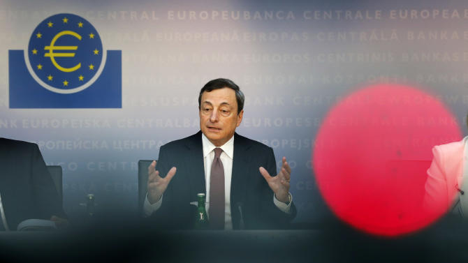 President of European Central Bank, ECB, Mario Draghi speaks during a news conference in Frankfurt, Germany, Thursday, June 6, 2013, following a meeting of the ECB governing council concerning the further strategies in the European financial crisis. Draghi said the economy of 17 European Union countries that use the euro would shrink 0.6 percent this year compared with the previous forecast of a 0.5 percent decline. (AP Photo/Michael Probst)